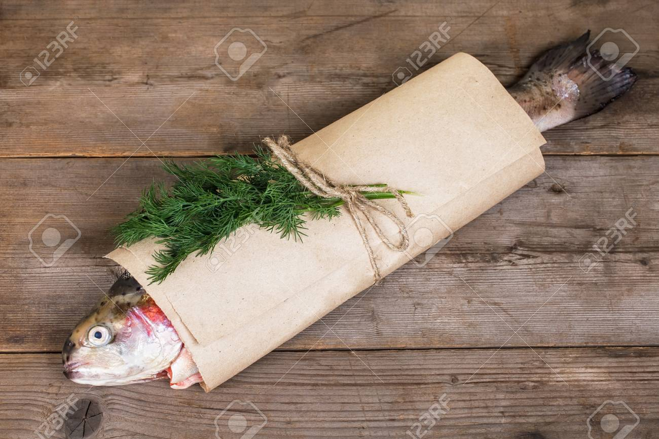 Fresh salmon on in the paper-bag on old wooden table Stock Photo - 17446257