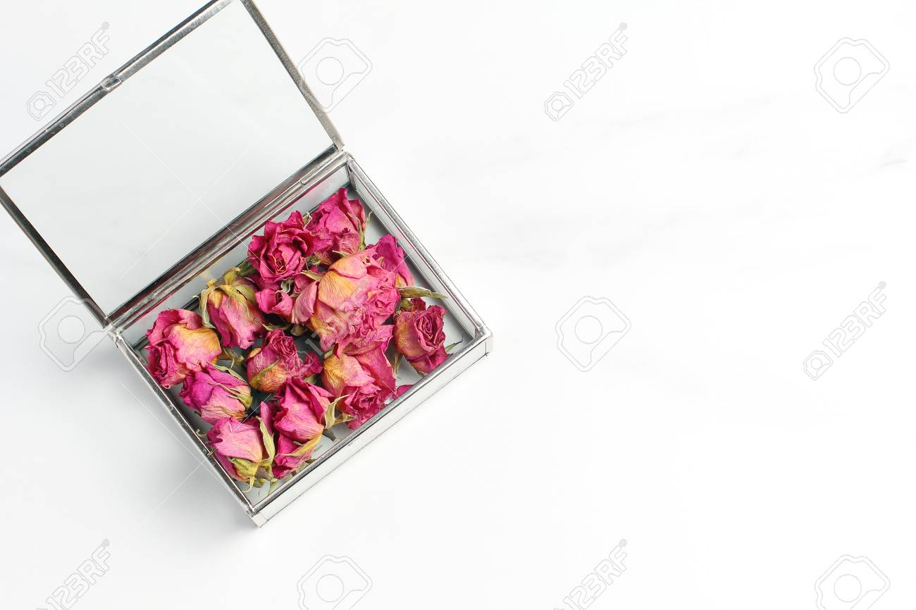 Buds Of Roses In A Glass Box On A Marble Table Pink Dried Flowers