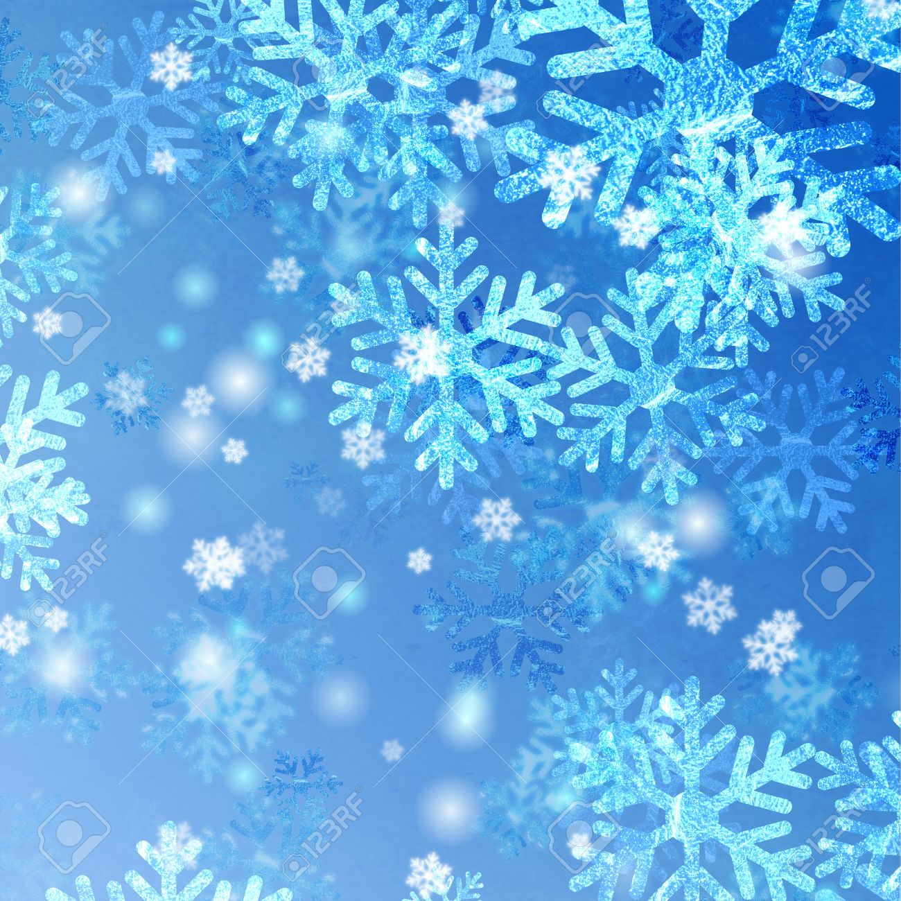 blue and white snowflakes over azure background