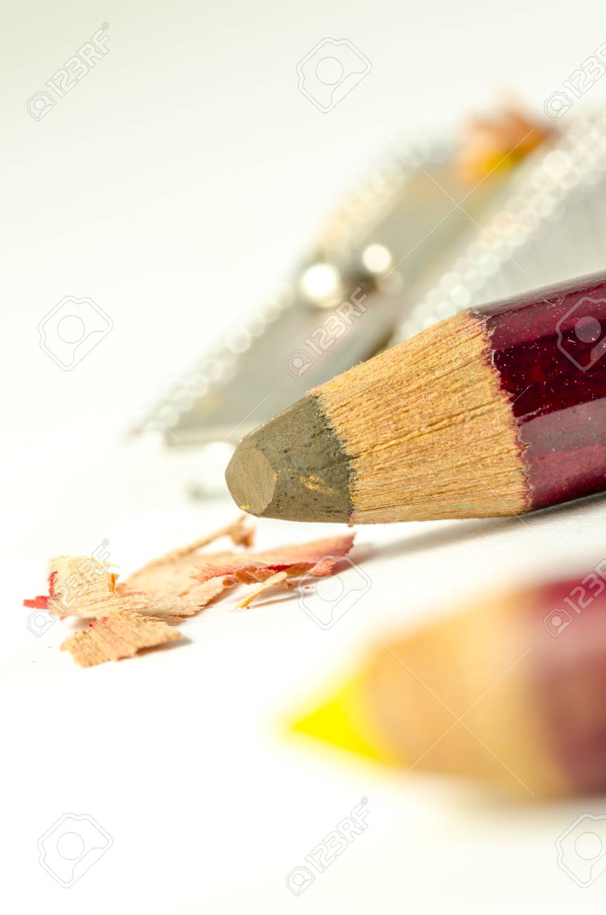colored pencils with sharpened pencil sharpner in the background