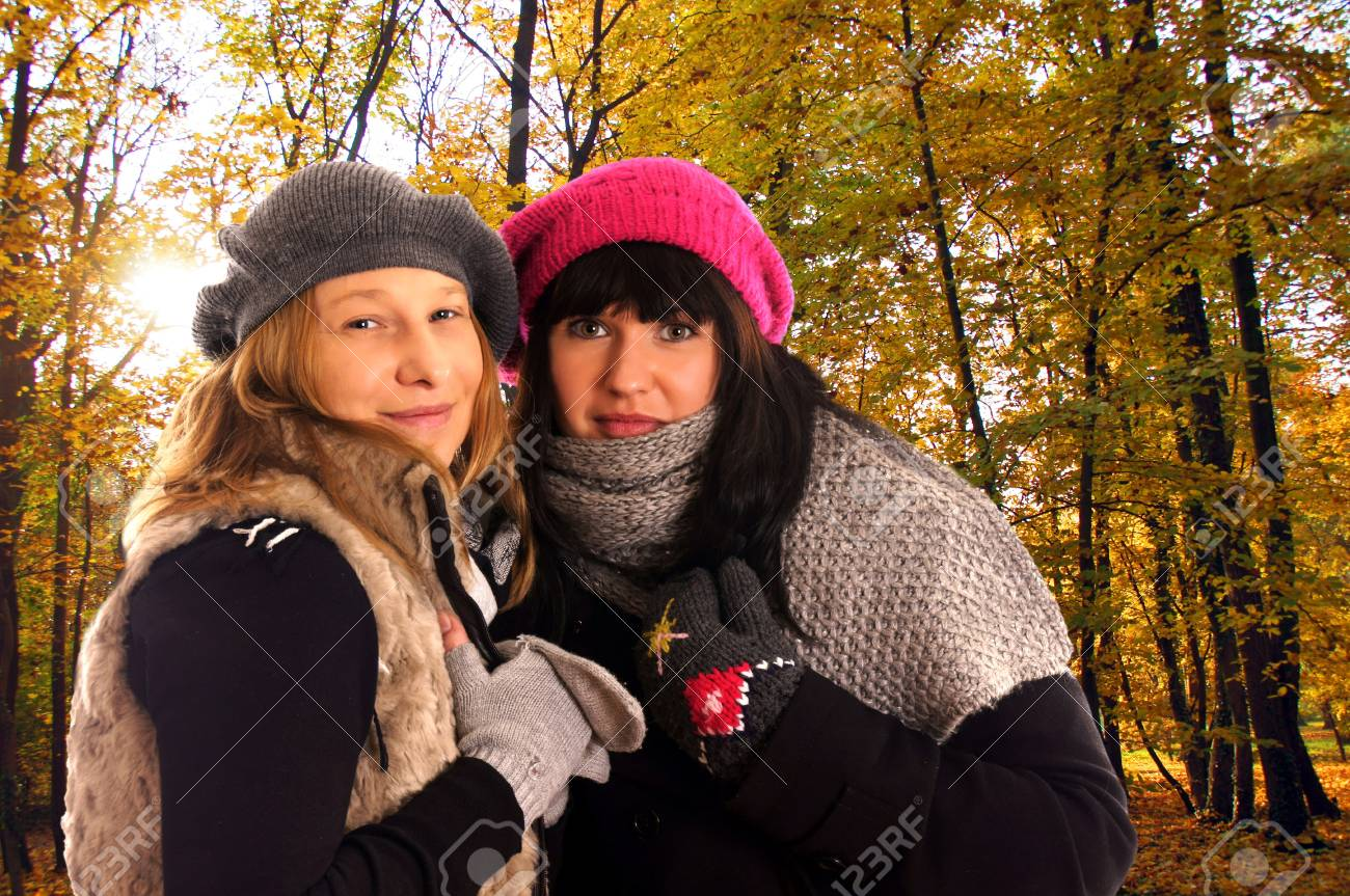 two woman in autumn forrest Stock Photo - 15205187