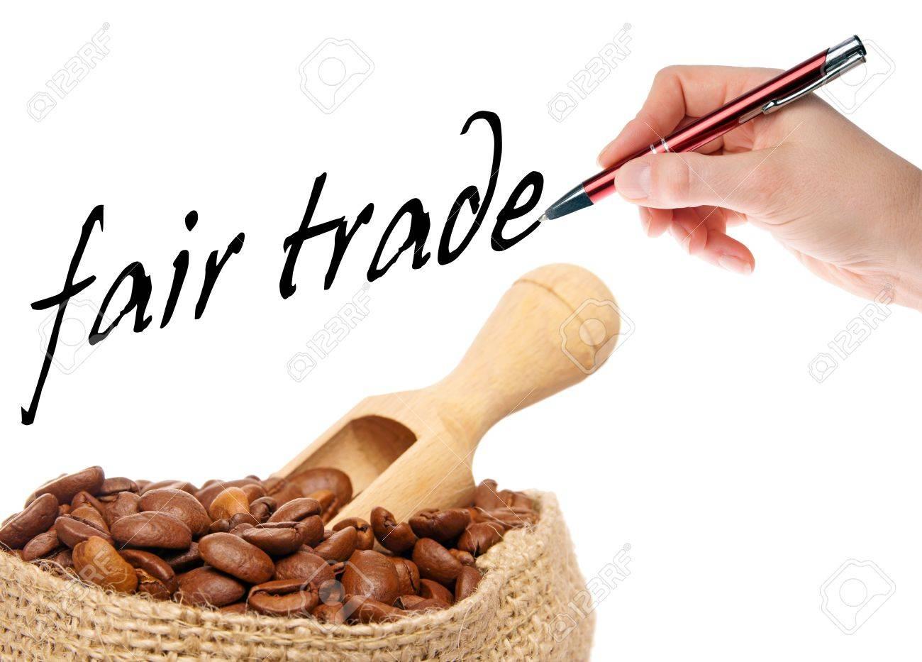 coffee beans with hand writes fair trade - 16695507