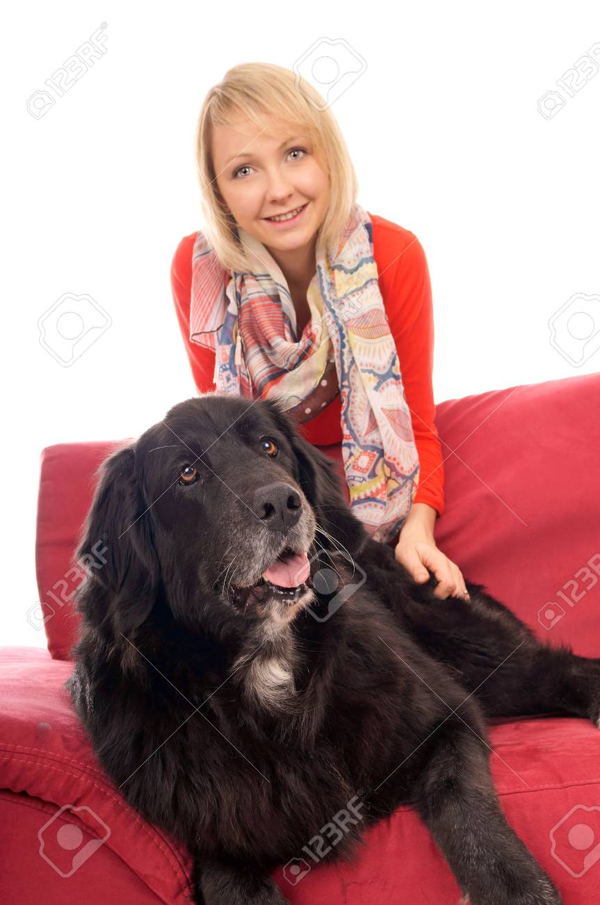 Young woman with her dog on a couch Stock Photo - 17100186
