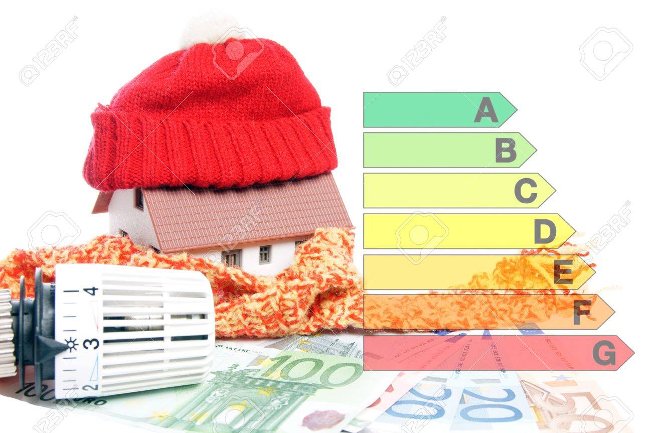 small house with euro money and energy scale Stock Photo - 17837564
