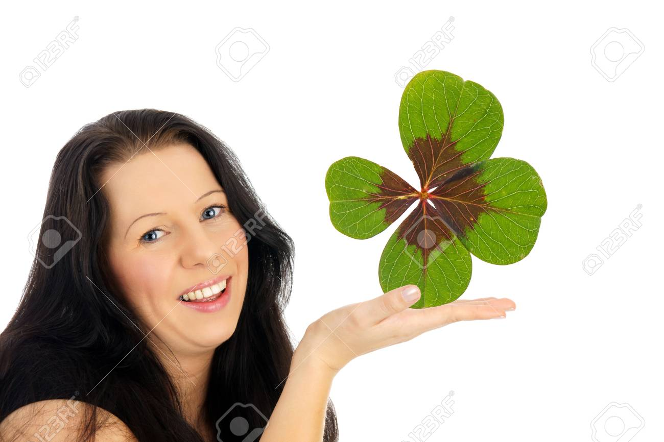 Woman with clover in a hand Stock Photo - 18257993