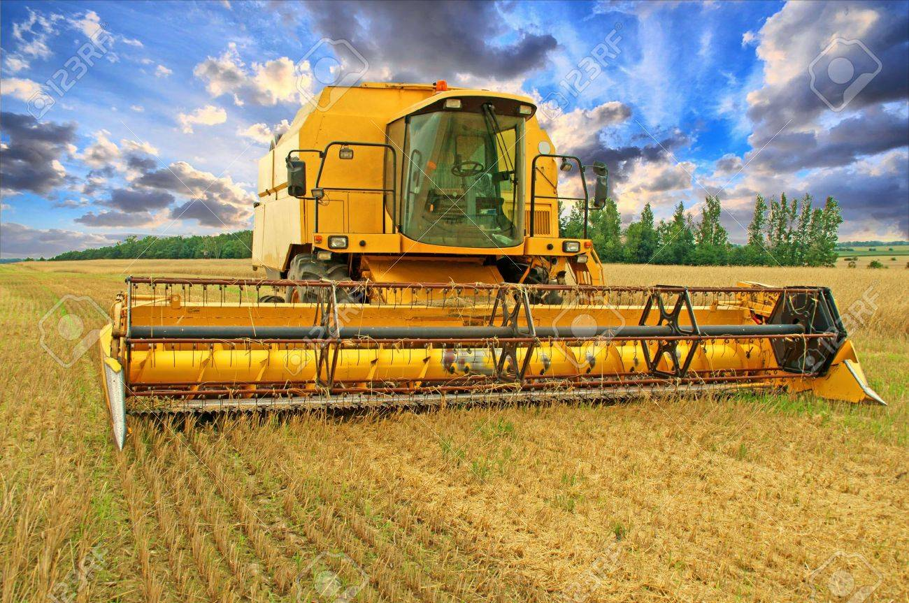 Combine Harvester and sky with beautiful clouds - 18655244