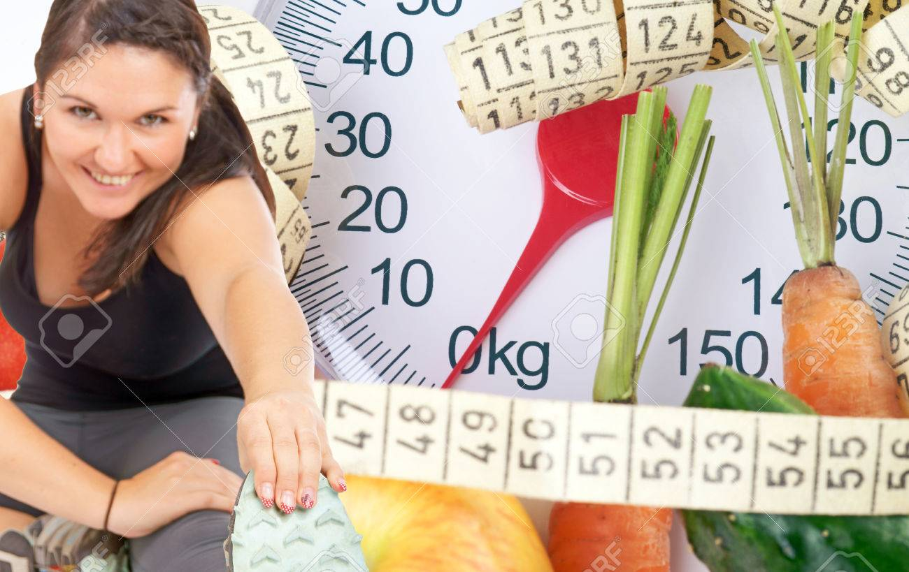 Woman doing sport and body scale with fruits and vegetables - 23146992