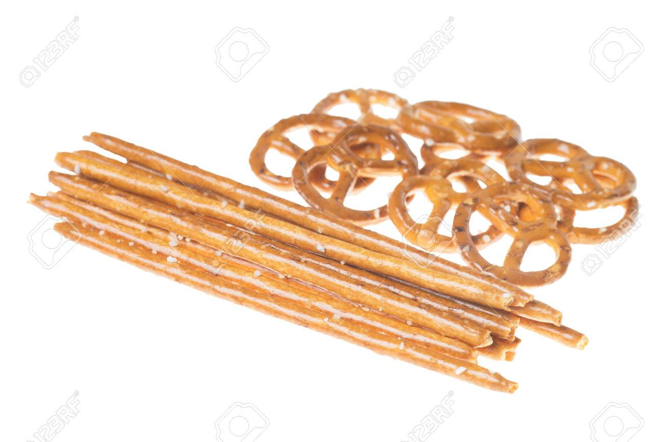 Salty sticks and pretzels isolated over a white background Stock Photo - 26076077