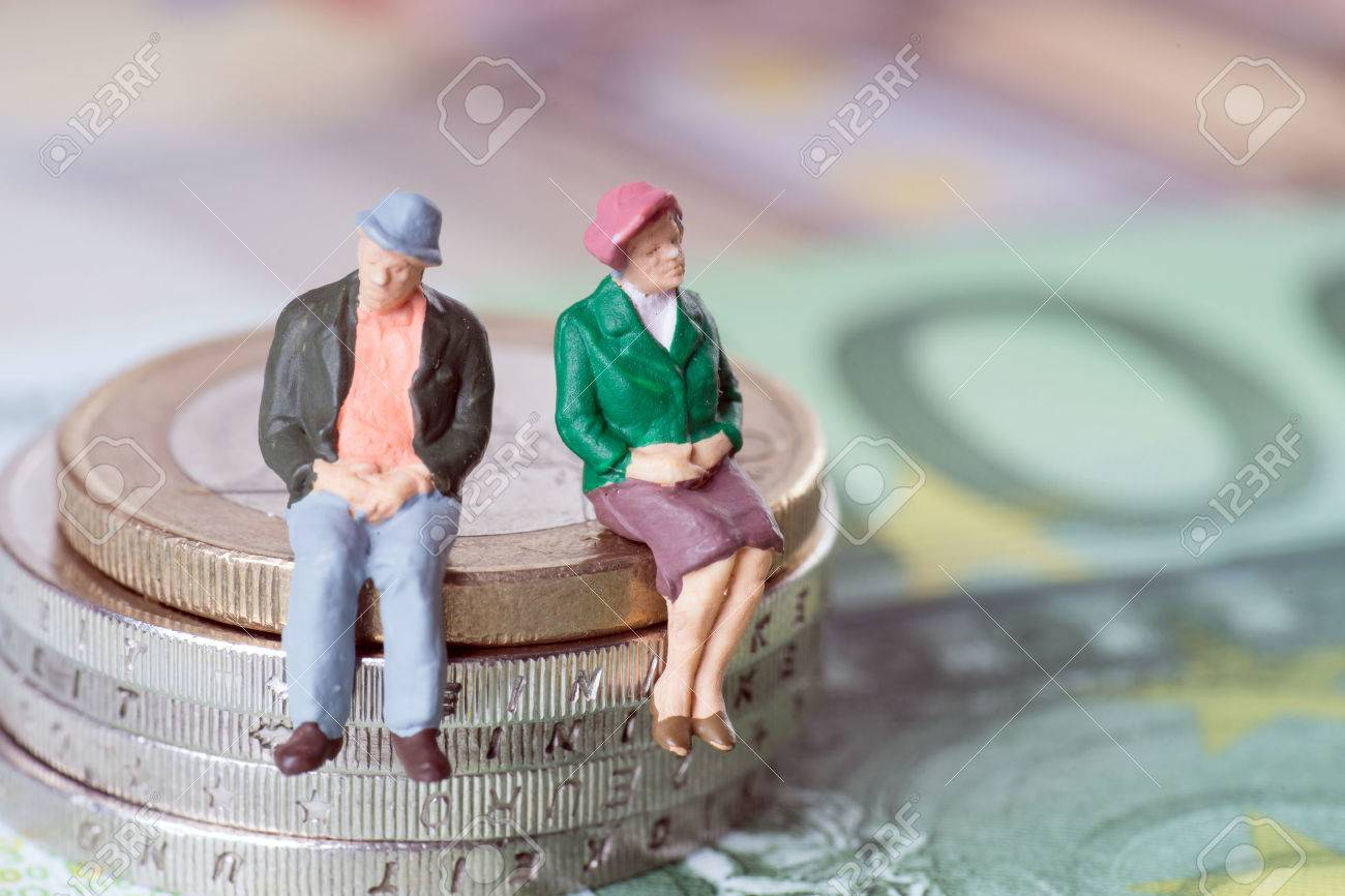 Grandma and Grandpa on a stack of euro coins - 26894003