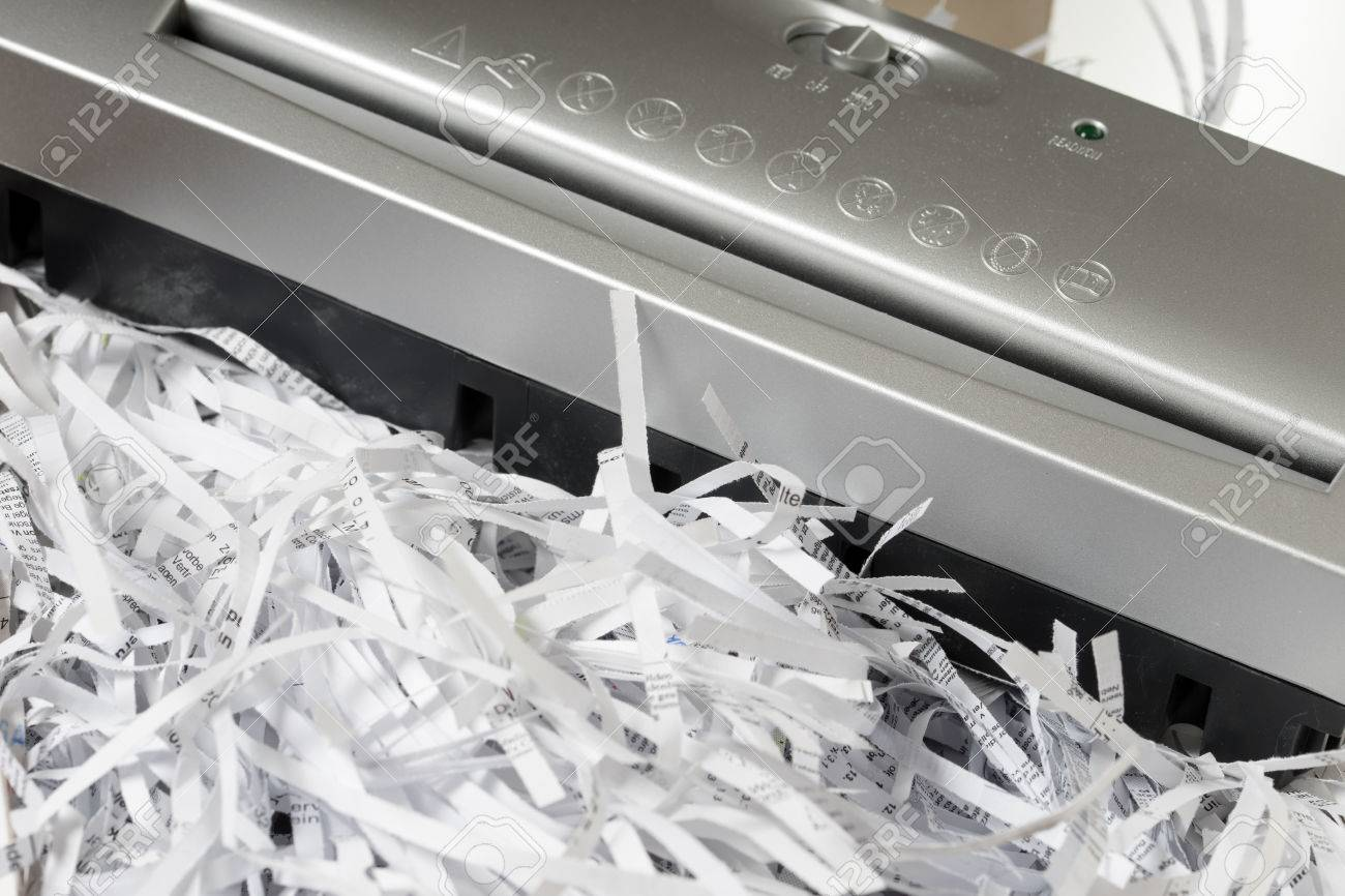 Scraps of paper from a paper shredder - 52208997