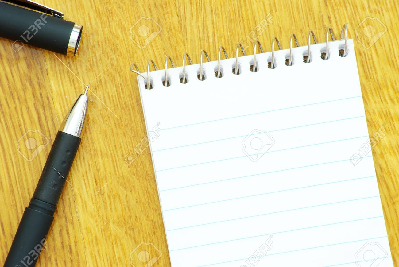 black pen and notebook in wood Stock Photo - 8166109