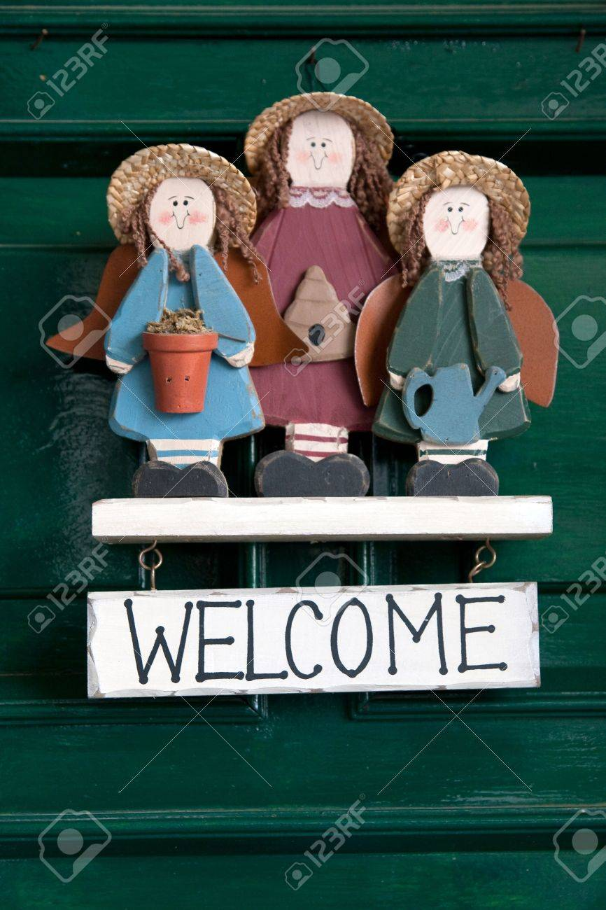 Welcome sign hanging at green doors. Stock Photo - 4776675