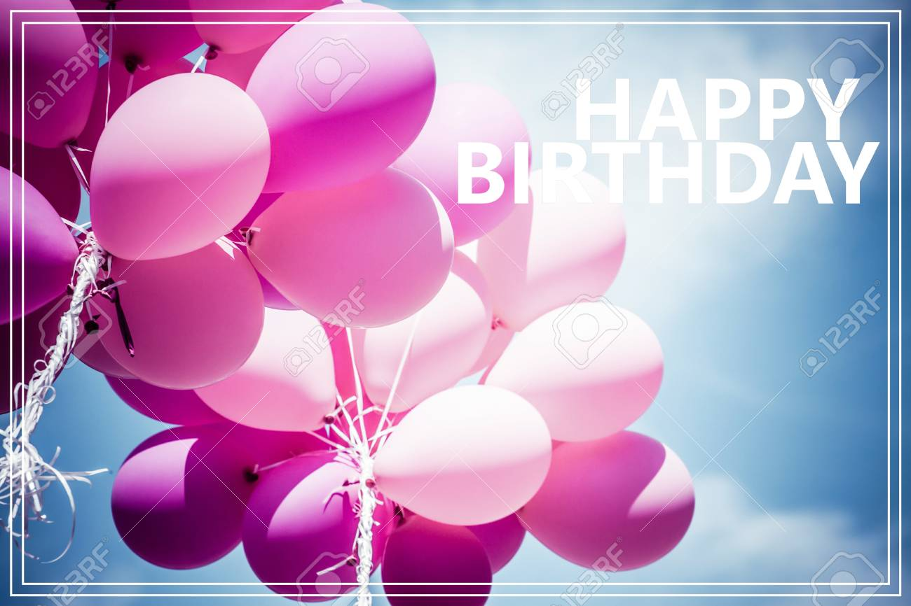Word Happy Birthday Over Pink Balloons And Blue Sky Background Stock