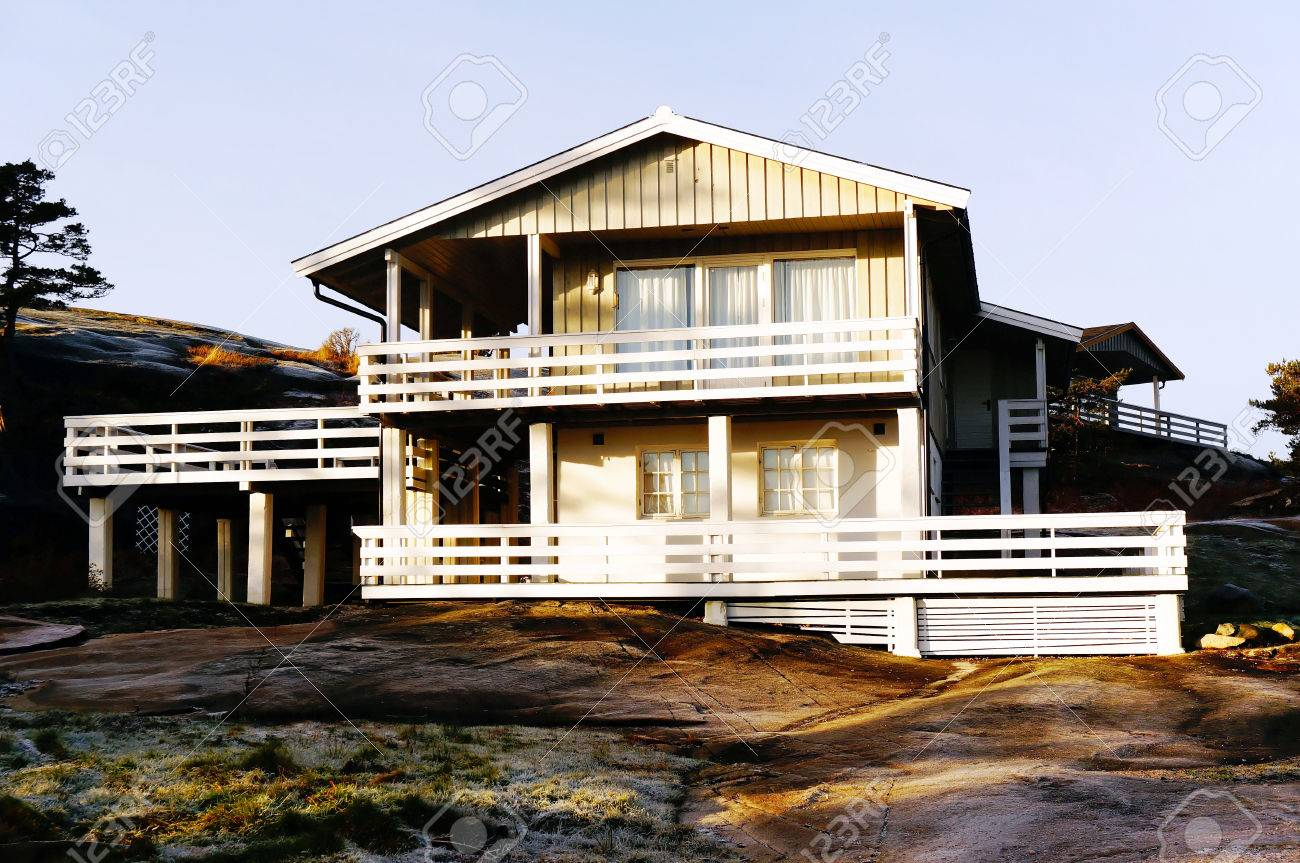 Storey Wooden Summer Cabin, White And Wooden Camp Cabin In Norway. North Sea  Coast