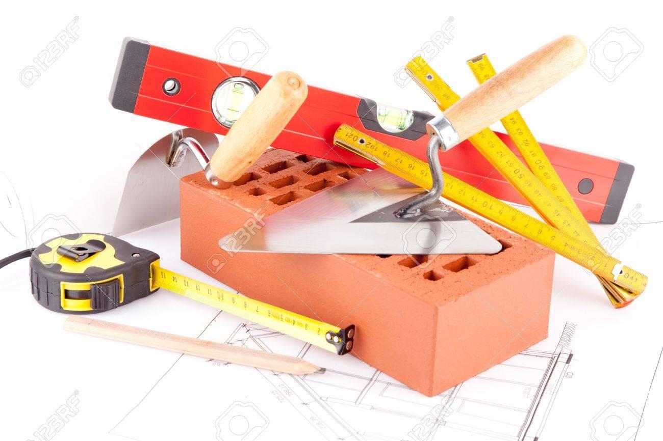 mason tools bricks and house construction plans stock photo mason tools bricks and house construction plans stock photo 15453775