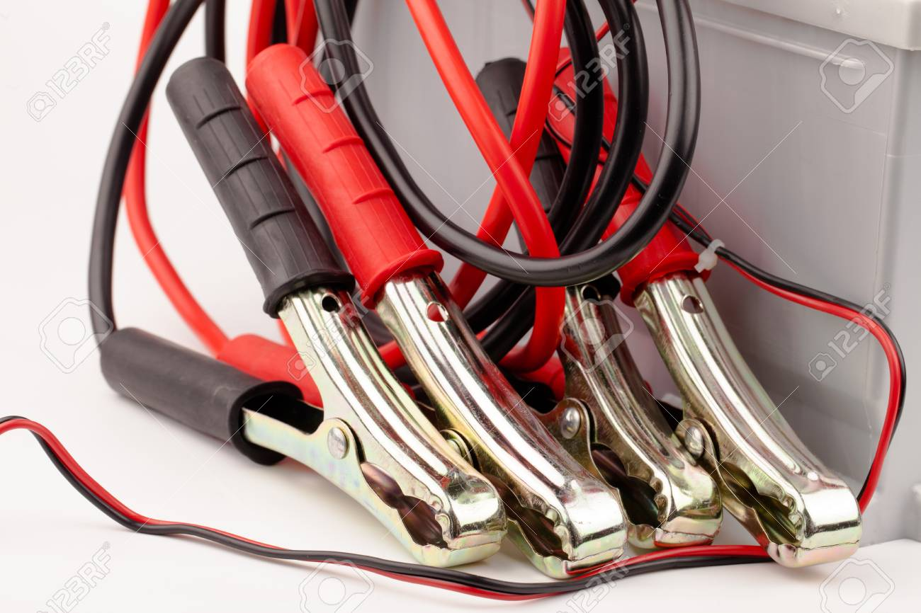 Car battery and jumper cables isolated on white Stock Photo - 18426083