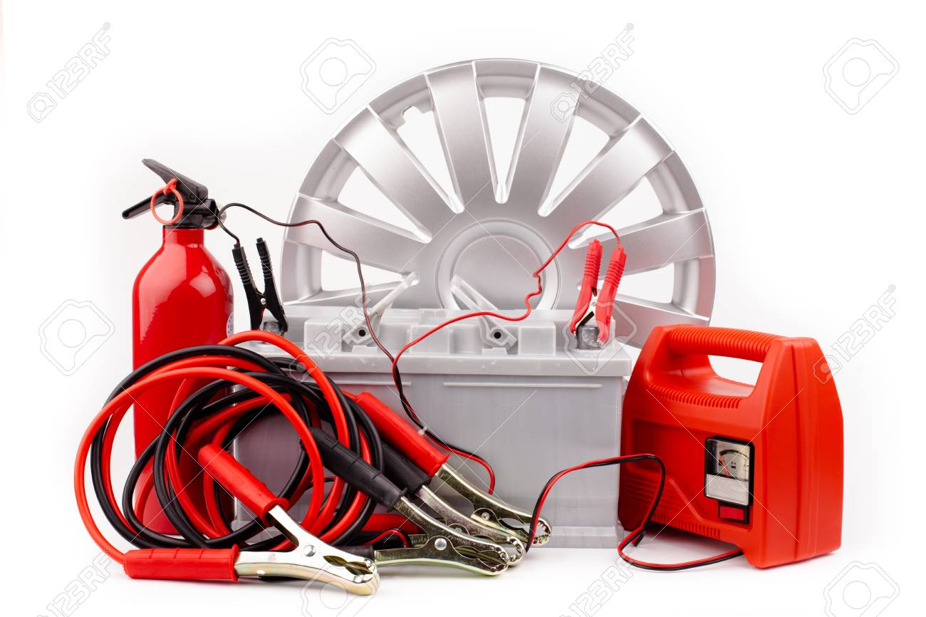Car battery and jumper cables isolated on white Stock Photo - 18426201