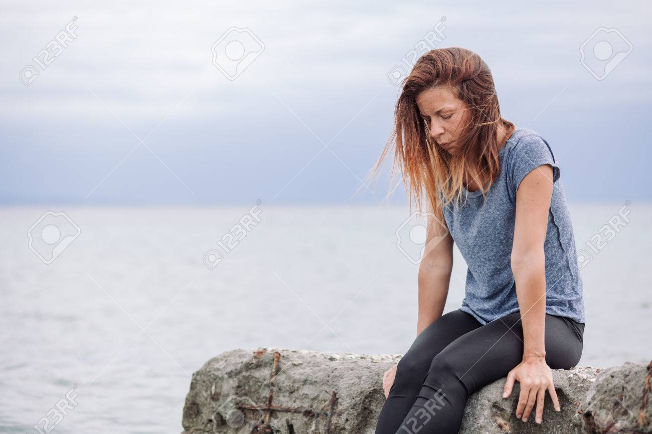 Woman alone and depressed at seaside - 83613741
