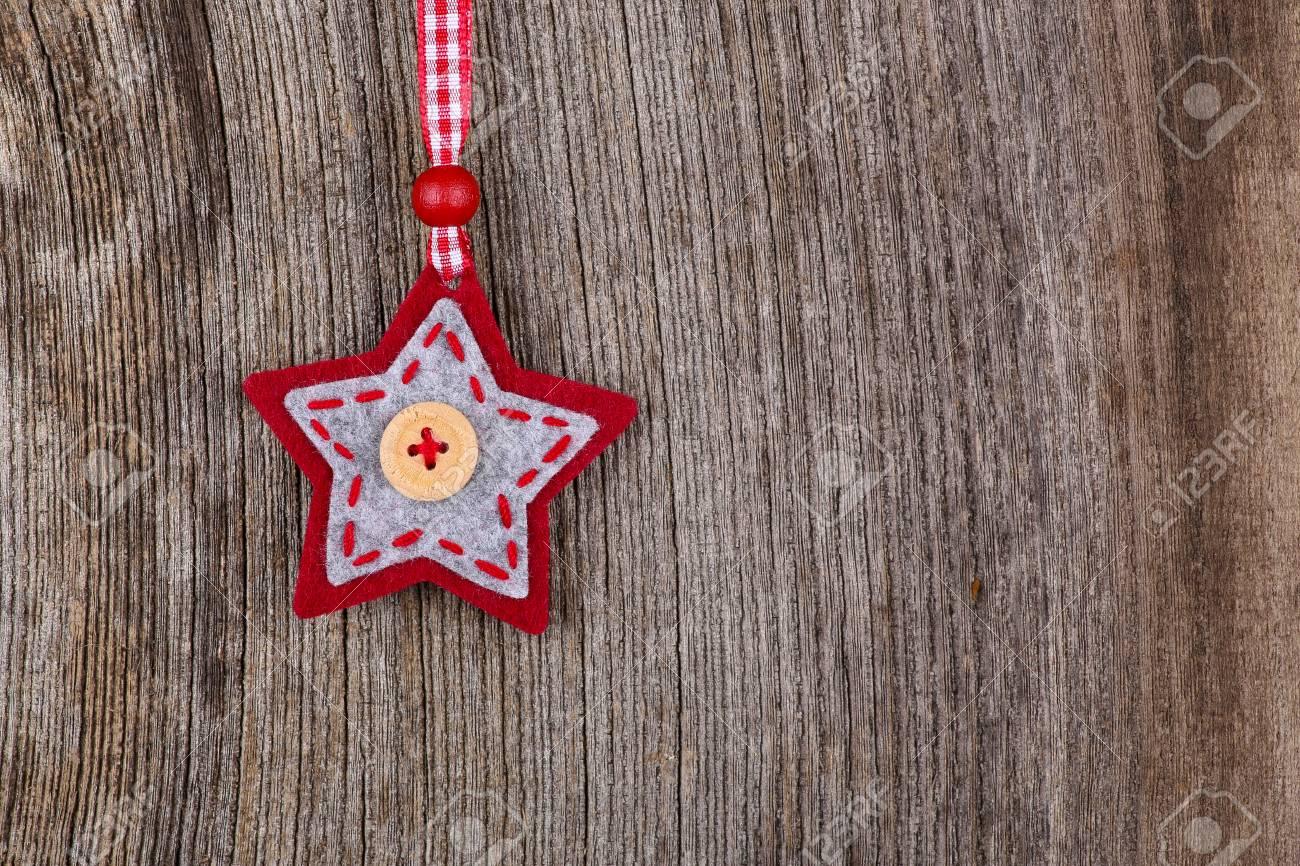 Stella Di Natale Legno.Tessuto Decorazione Stella Di Natale Rosso A Mano Su Rustico Elm Sfondo Di Legno Stile Retro Copia Spazio