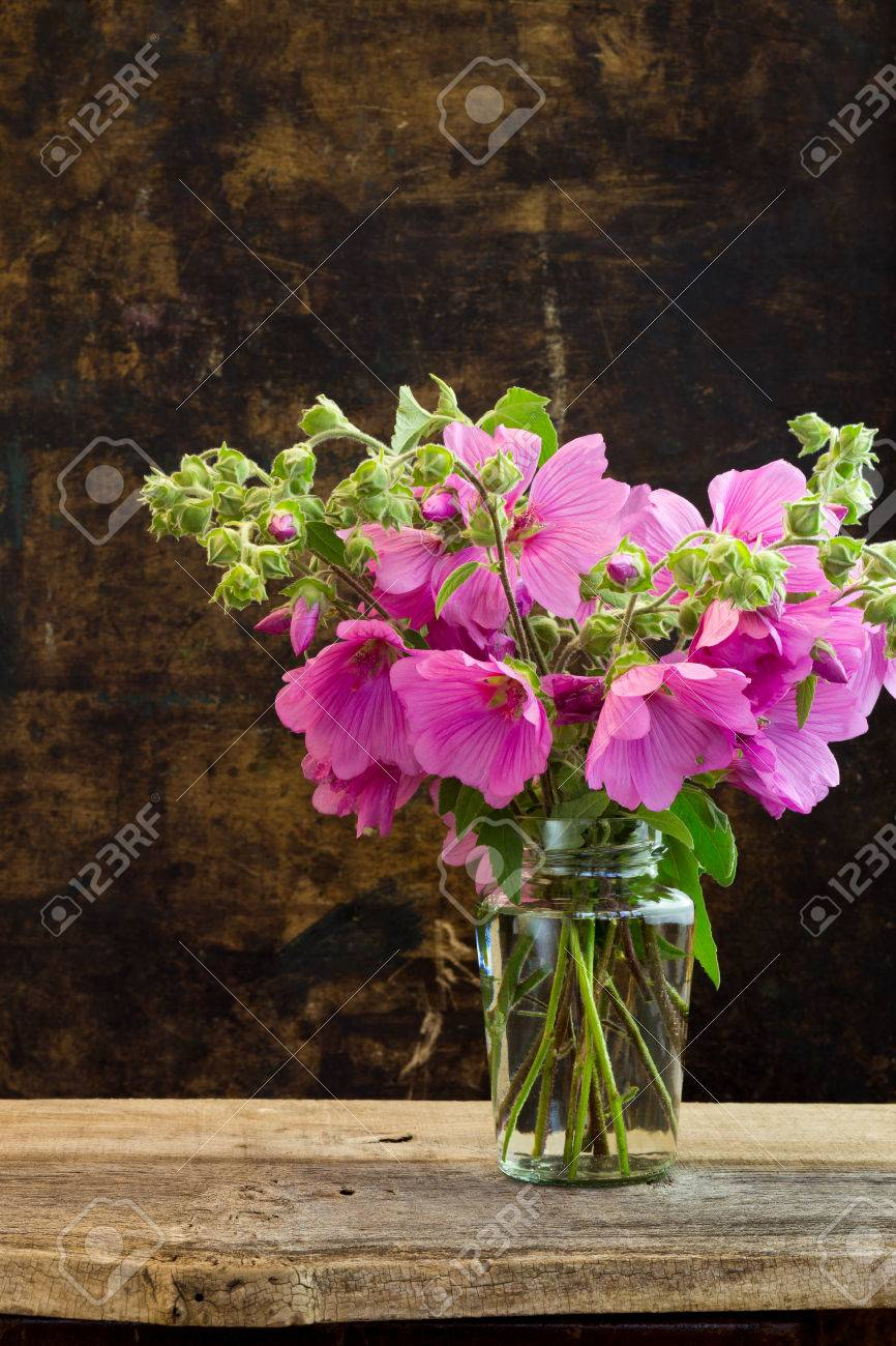 Pink Hibiscus Flowers Bouquet In A Vase On Dark Rustic Background ...