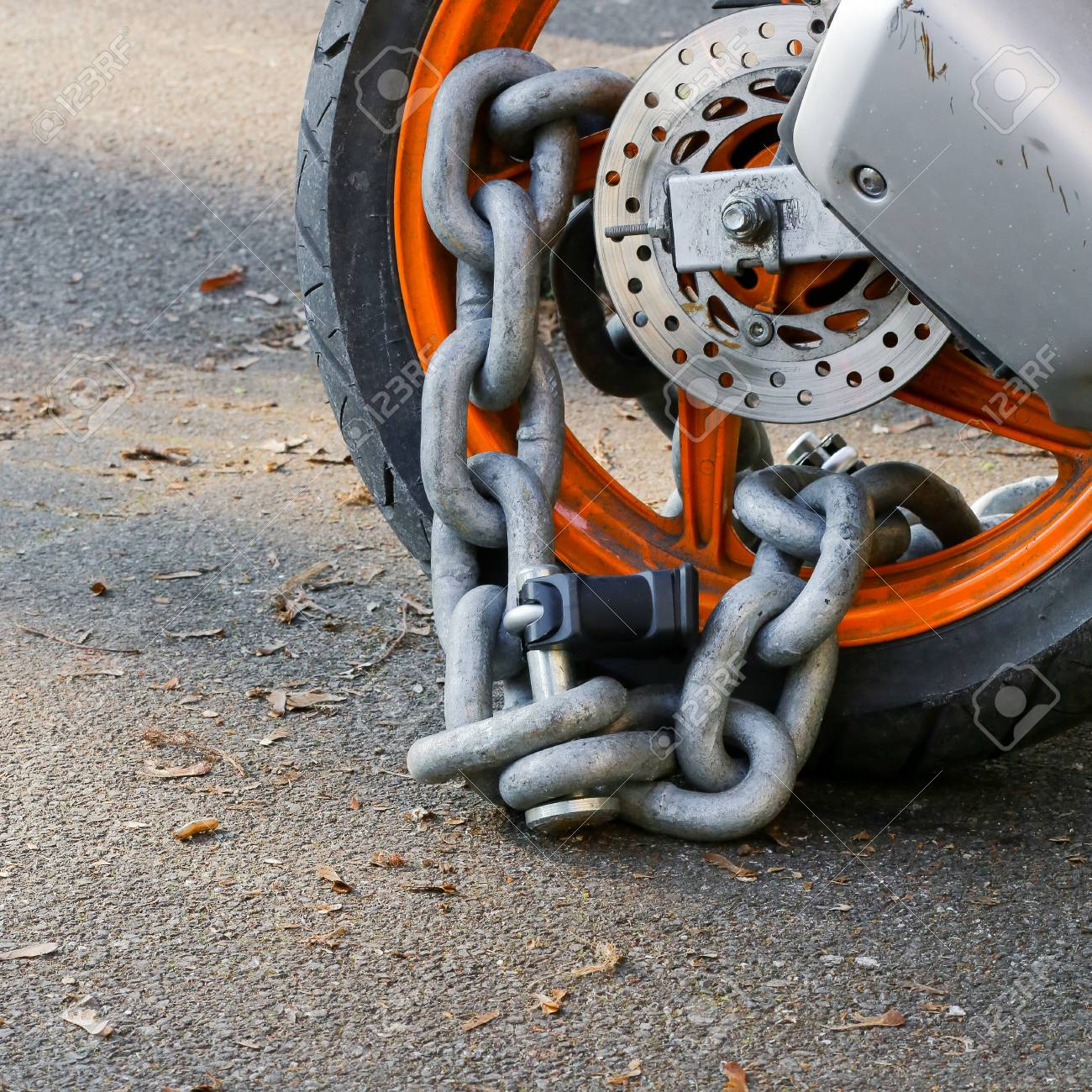 Motorcycle Anti-theft Chain With Padlock Security Lock On Rear.. Stock  Photo, Picture And Royalty Free Image. Image 70818251.