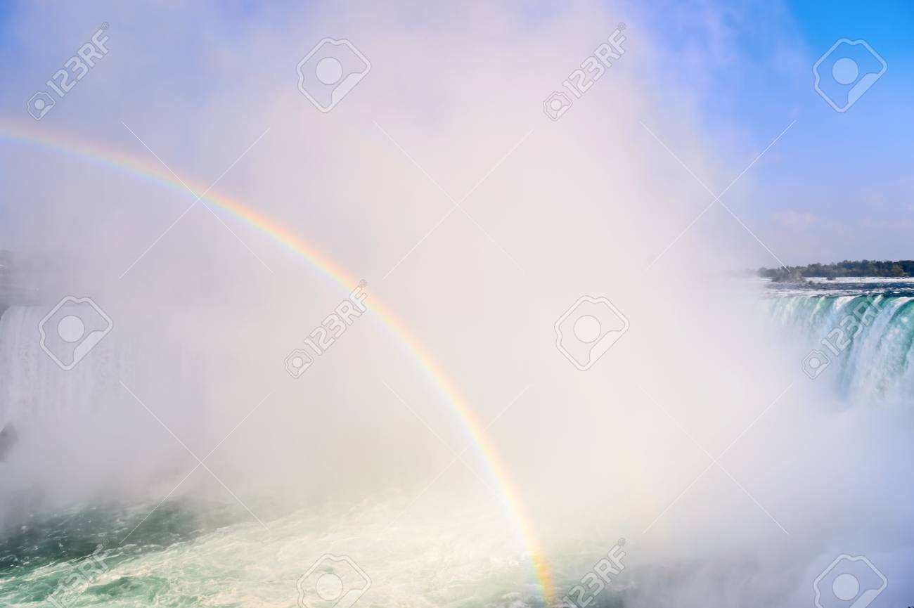 Rainbow rises from the mist at Horseshoe, Niagara Falls, Ontario, Canada Stock Photo - 15888454