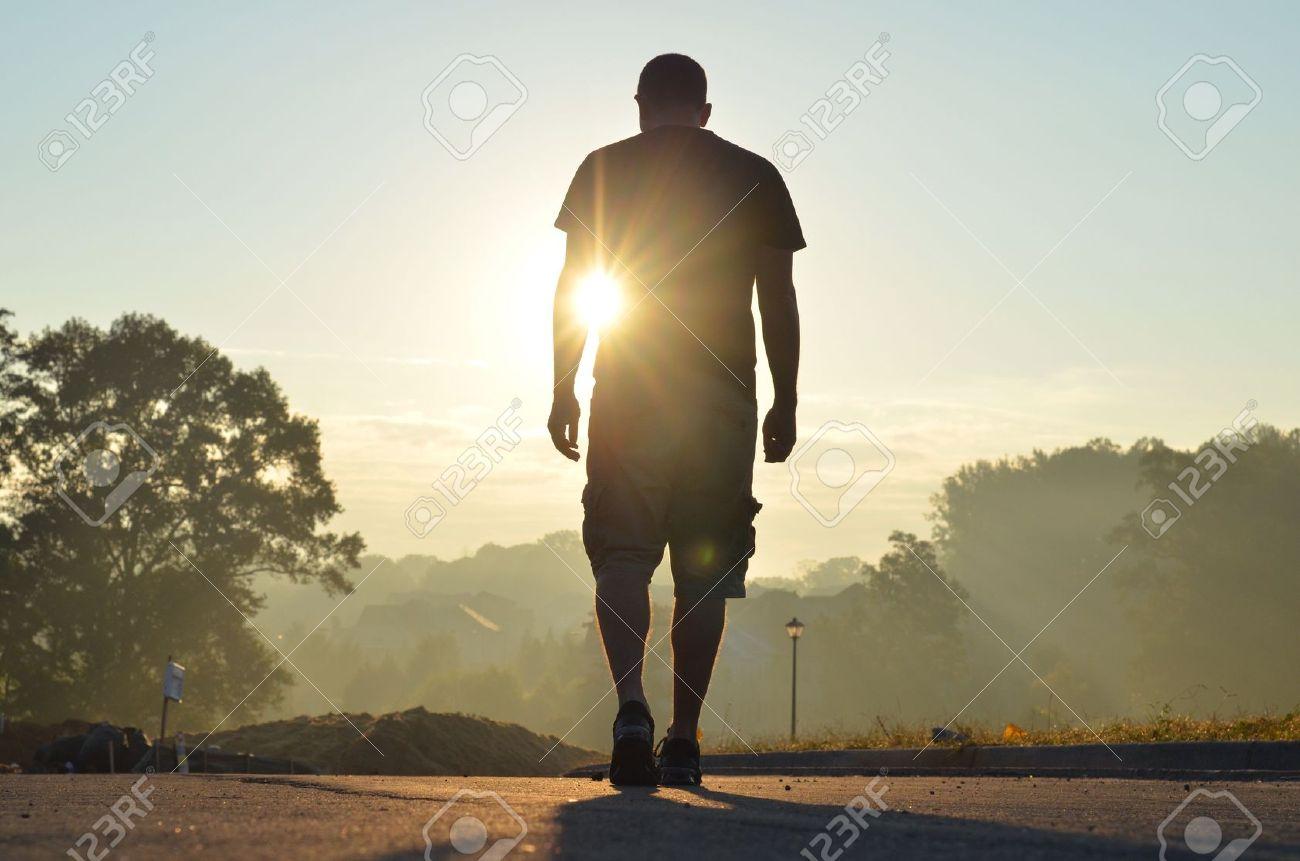Man Walking Alone In Nature