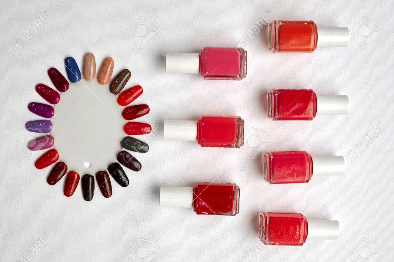 Red Polish Bottles And Fake Nails On A White Background. Stock Photo ...