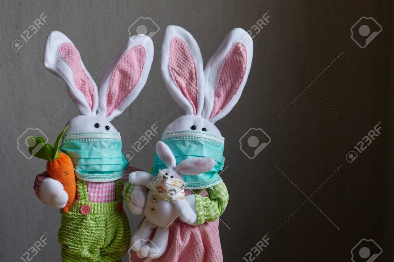 144112405 easter family of rabbits wearing medical masks coronavirus