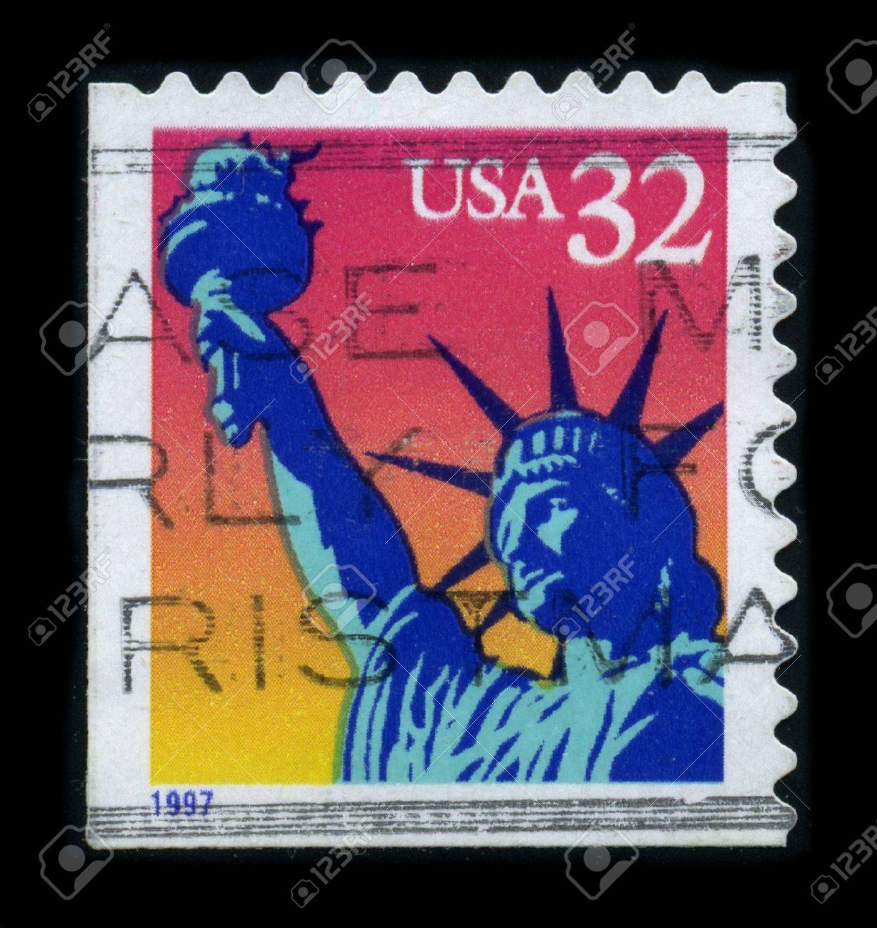 USA-CIRCA 1997: A stamp dedicated to the The Statue of Liberty (Liberty Enlightening the World [French: La Liberte eclairant le monde]) is a colossal neoclassical sculpture on Liberty Island in New York Harbor, designed by Frederic Bartholdi and dedicated Stock Photo - 8194337