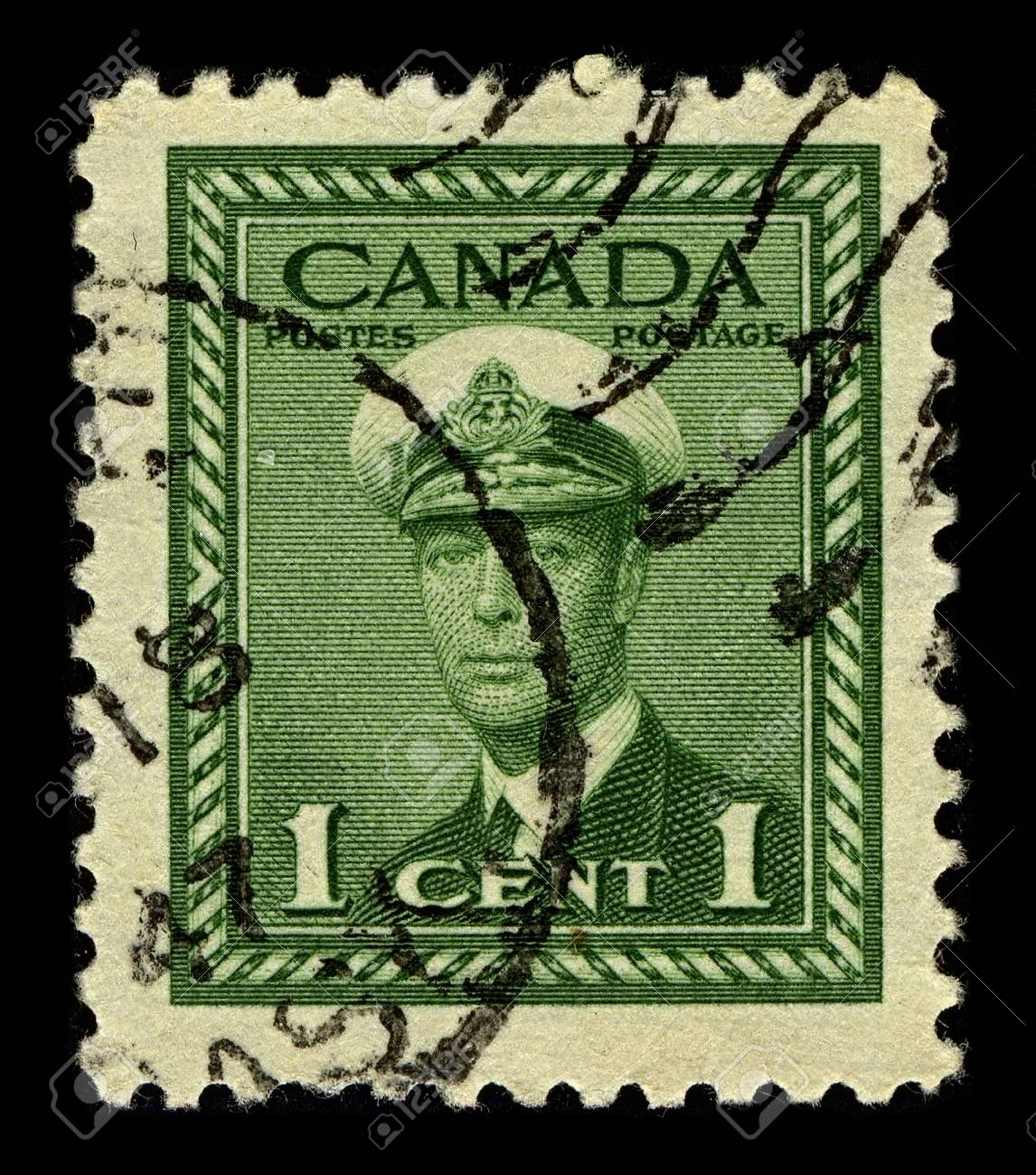 CANADA-CIRCA 1942:A stamp printed in CANADA shows image of George VI  was King of the United Kingdom and the Dominions of the British Commonwealth from 11 December 1936 until his death, circa 1942. Stock Photo - 10198276