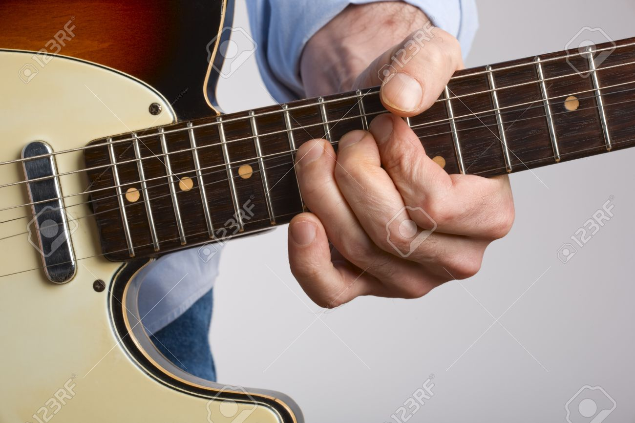 Close Up Of Electric Guitar Player Bending String Stock Photo
