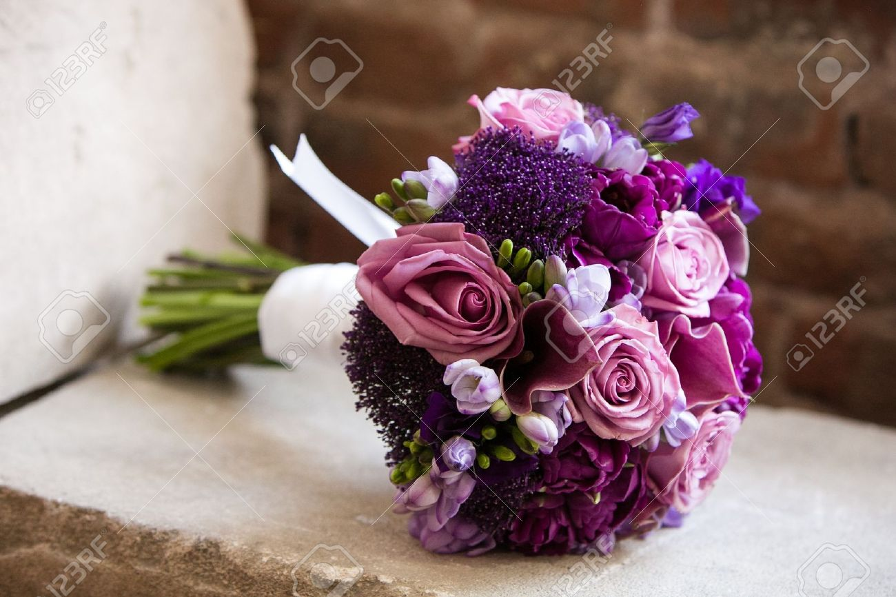 wedding bouquet on a brides wedding day stock photo picture and