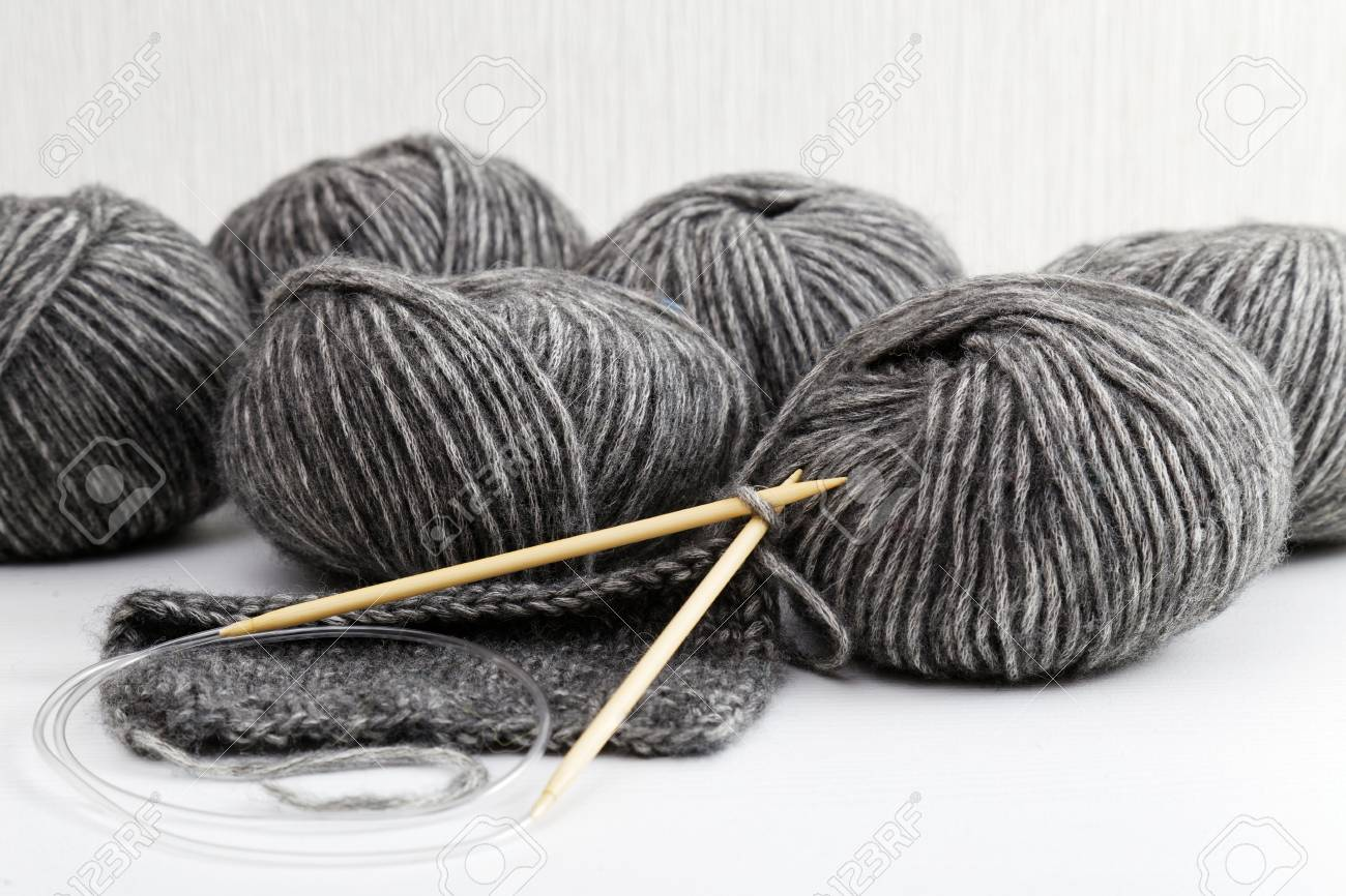 Balls Of Yarn For Knitted Handicrafts And Knitting Needles On