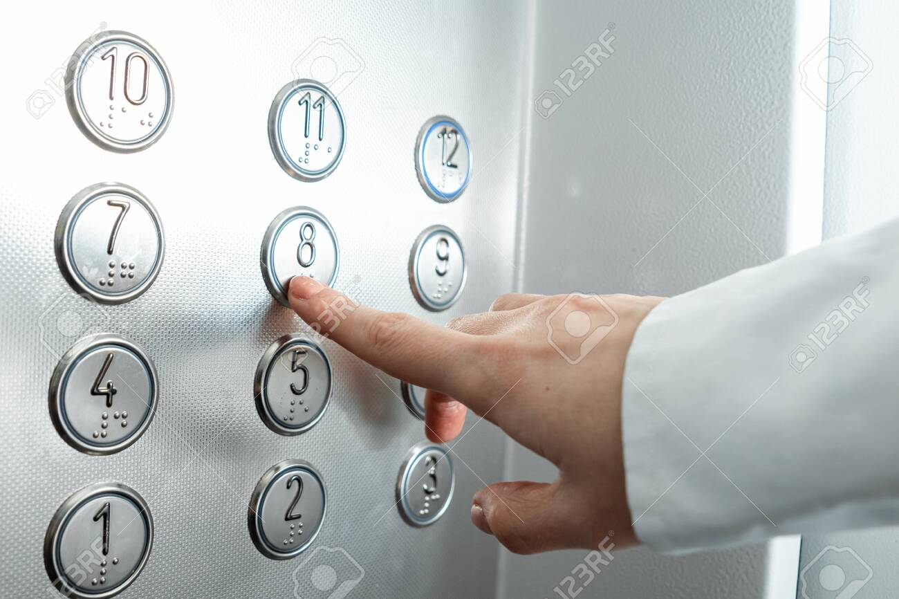 Female hand, finger presses the elevator button. up the career ladder - 139294175