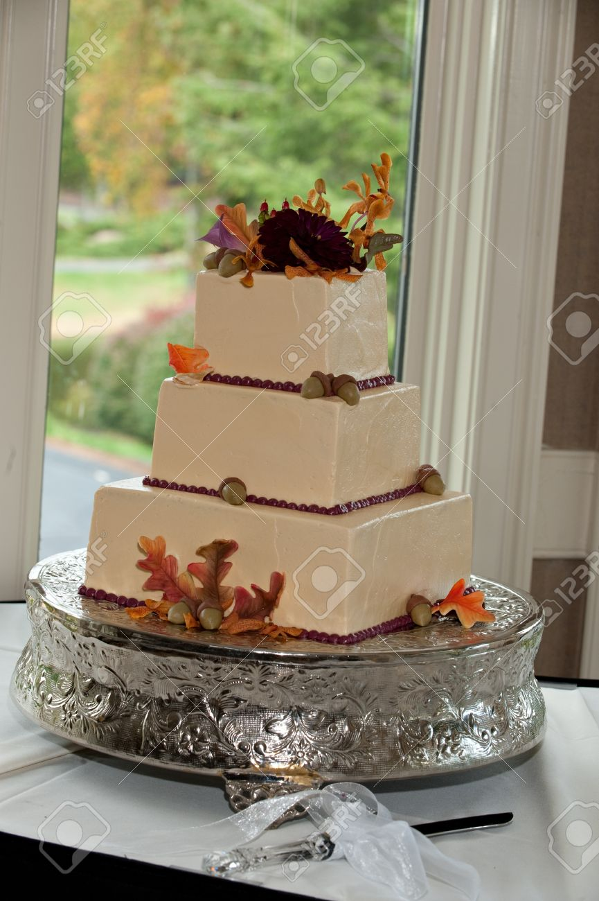 Leaves And Acorns Adorn This Fall Themed Three Tier Wedding Cake Each Is