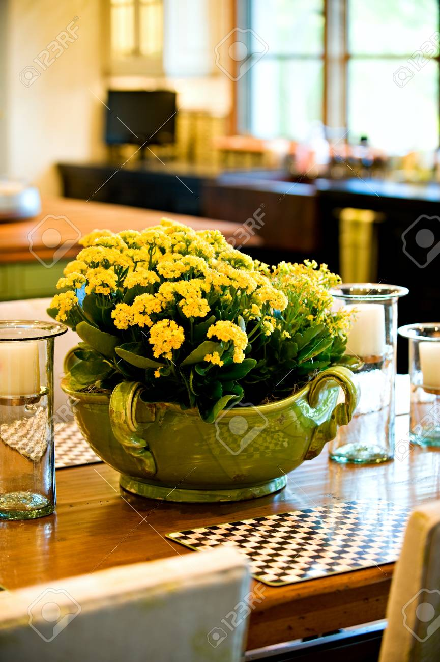 Beautiful yellow flower arrangement on the dining room table. Stock Photo - 11839445