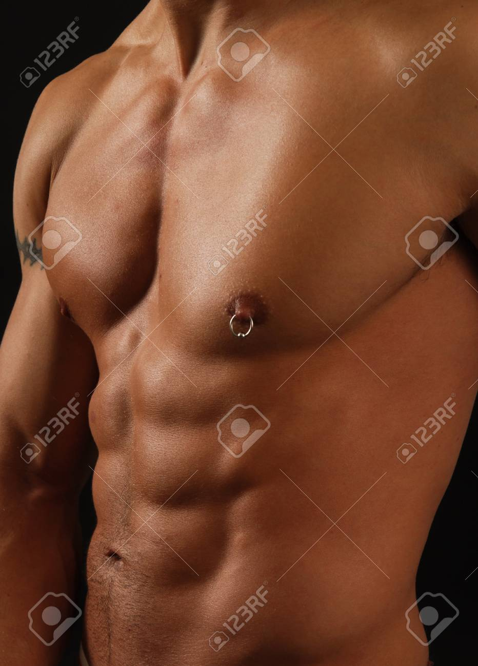 Close up of a muscular tan male torso Stock Photo - 9888219
