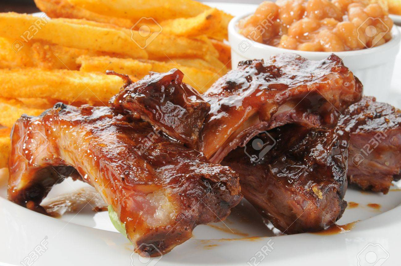 Close up of beef or pork ribs with fries and baked beans Stock Photo - 12268314