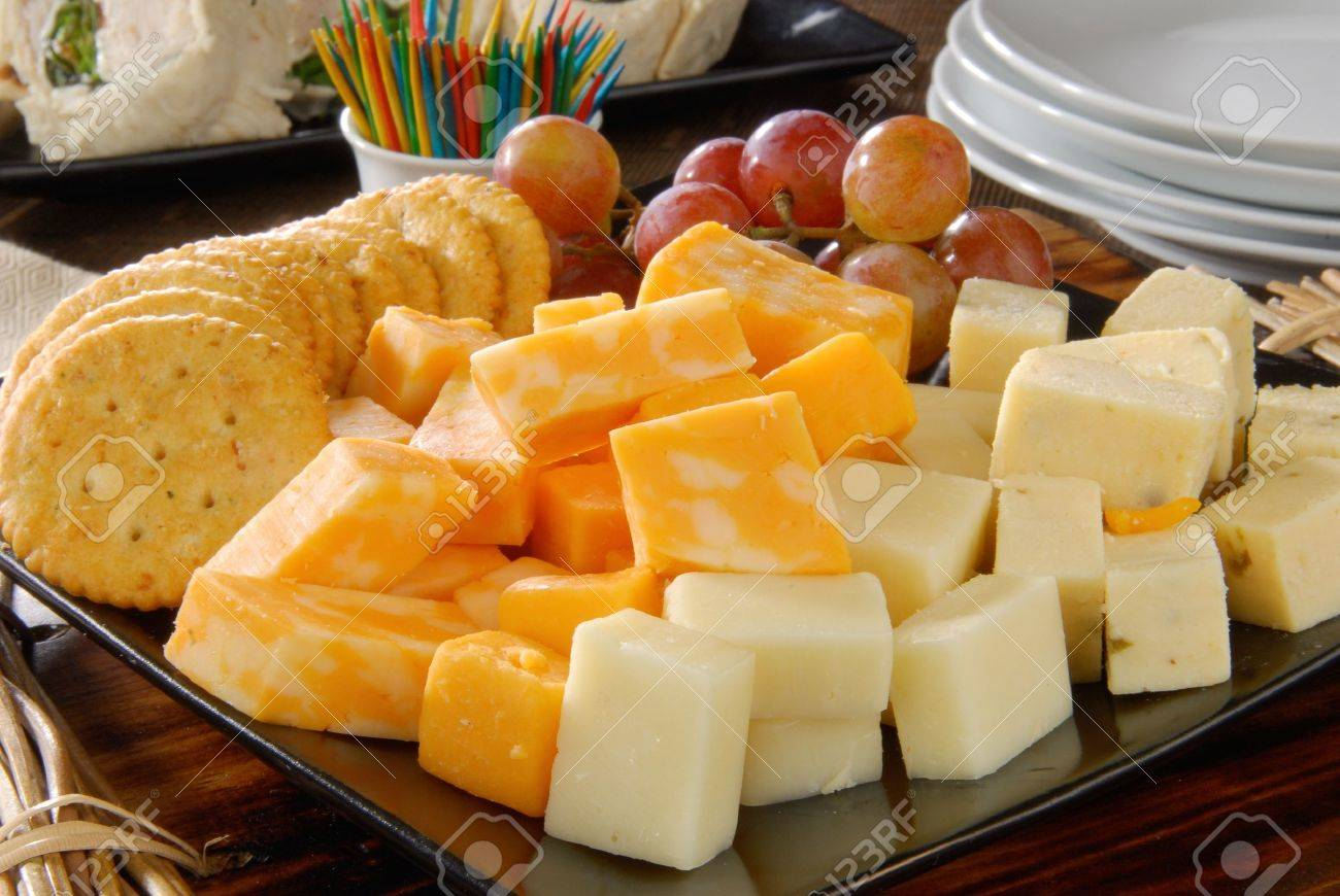 A plate of cheese and crackers on a party buffet table Stock Photo - 12268507 & A Plate Of Cheese And Crackers On A Party Buffet Table Stock Photo ...