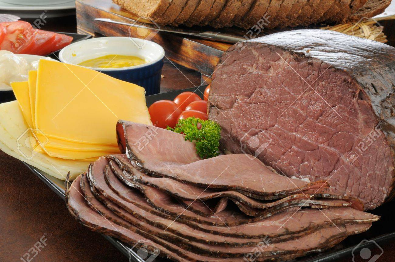 Sliced roast beef package - Stock Photo Thin Sliced Roast Beef With Cheeses Condiments And Sliced Rye Bread For Sandwiches