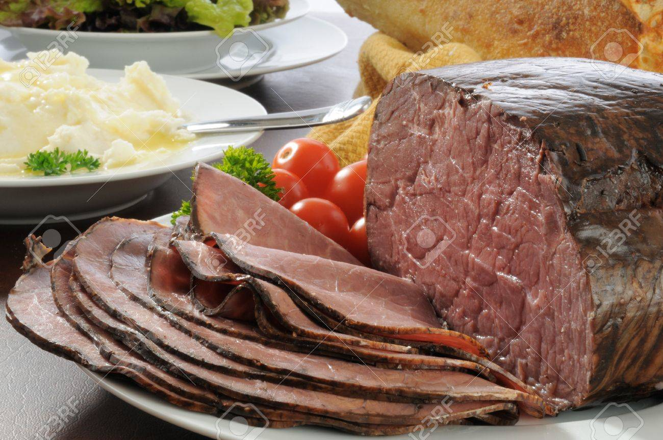 Sliced roast beef package - Stock Photo Thin Sliced Slow Cooked Roast Beef With Mashed Potatoes And Salad