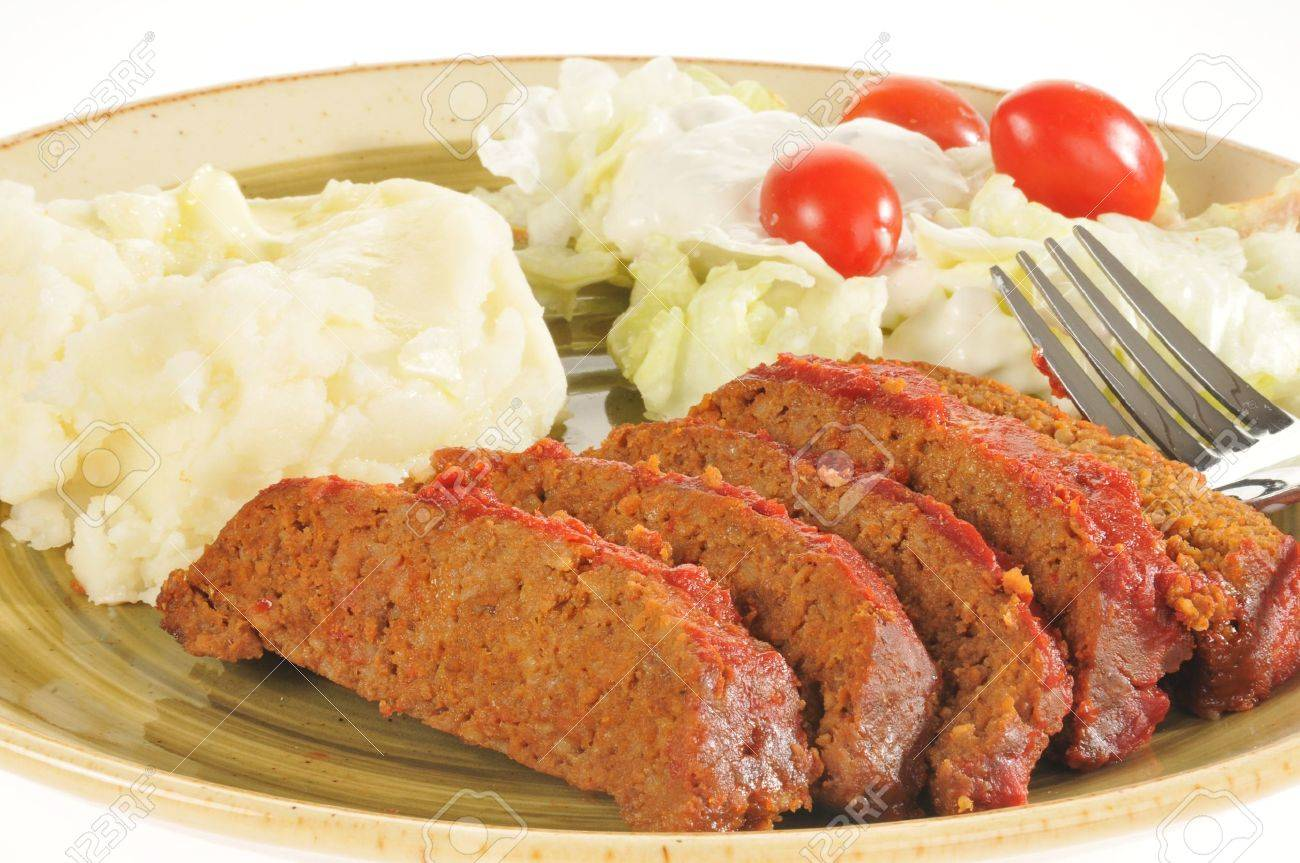 A closeup of a meatloaf dinner on a white background Stock Photo - 12675821