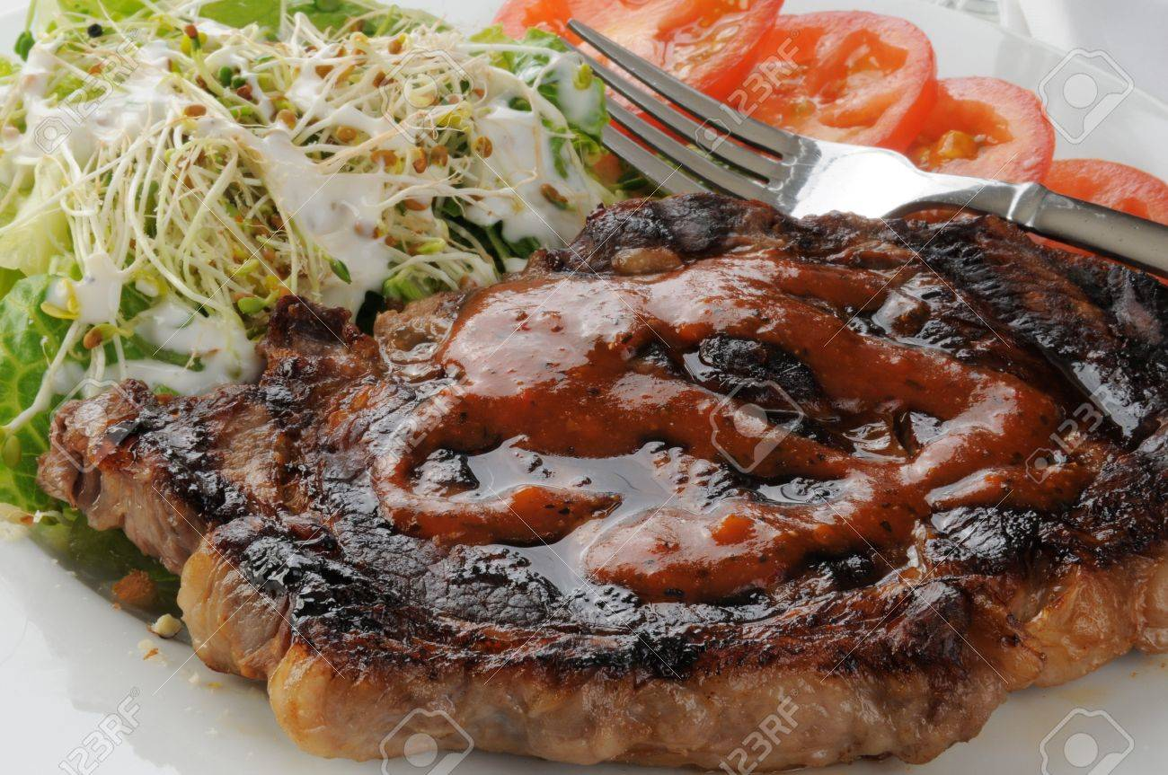 A juicy broiled rib steak with salad, alfalfa sprouts and tomatoes Stock Photo - 12675937