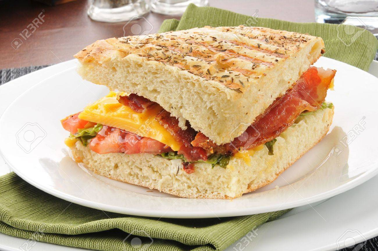 A BLT And Cheese Sandwich On Focaccia Bread Stock Photo