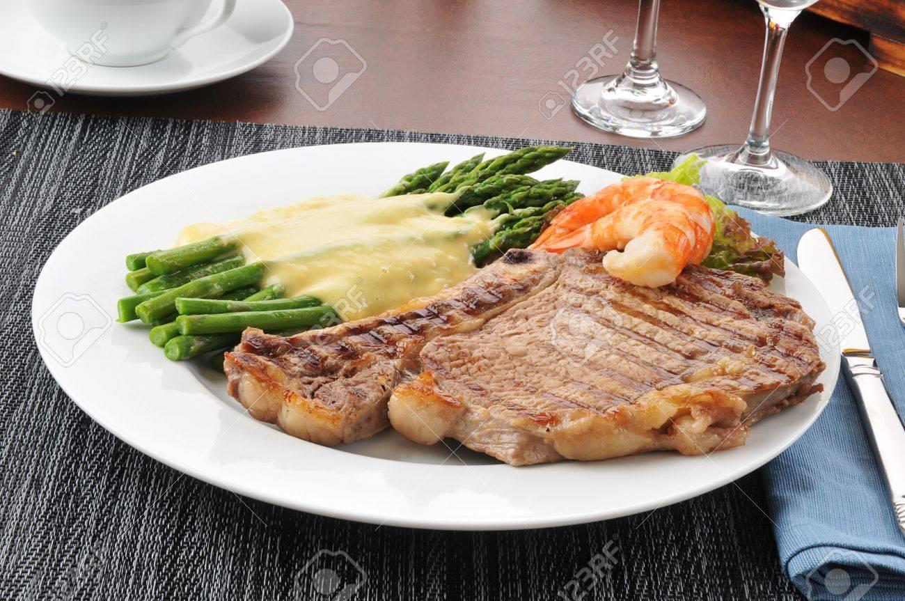 A steak and asparagus dinner with shrimp Stock Photo - 15094808