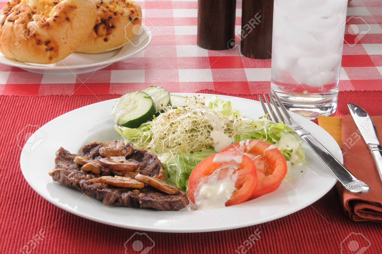Grilled steak with lettuce, alfalfa sprouts and sliced tomato Stock Photo - 15229951