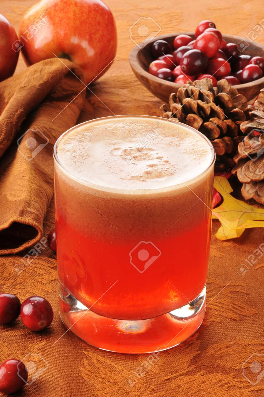 A glass of fresh juiced cranberry apple juice Stock Photo - 15660440