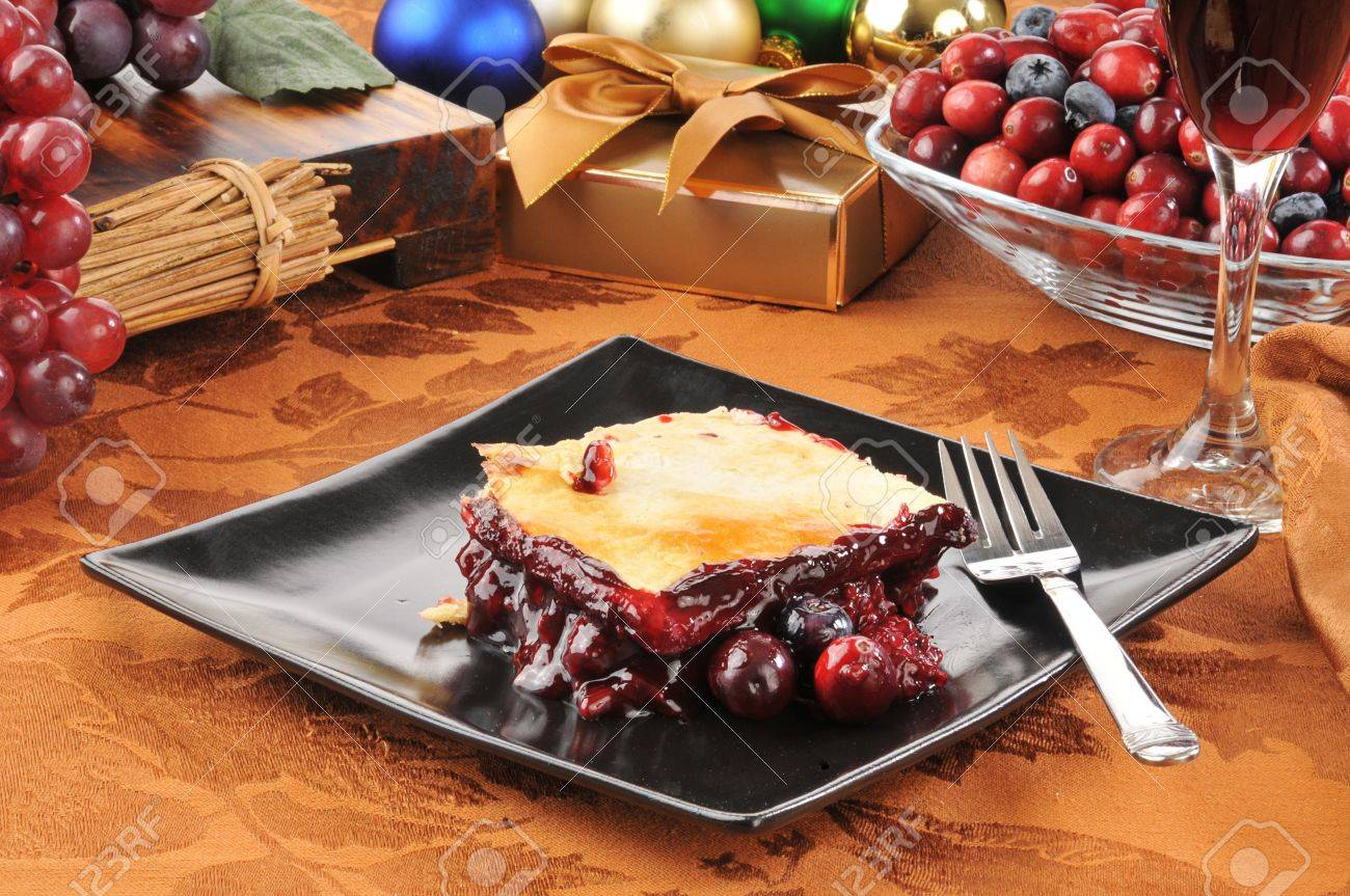 A slice of fruit cobbler with red wine on a Christmas table Stock Photo - 15869010