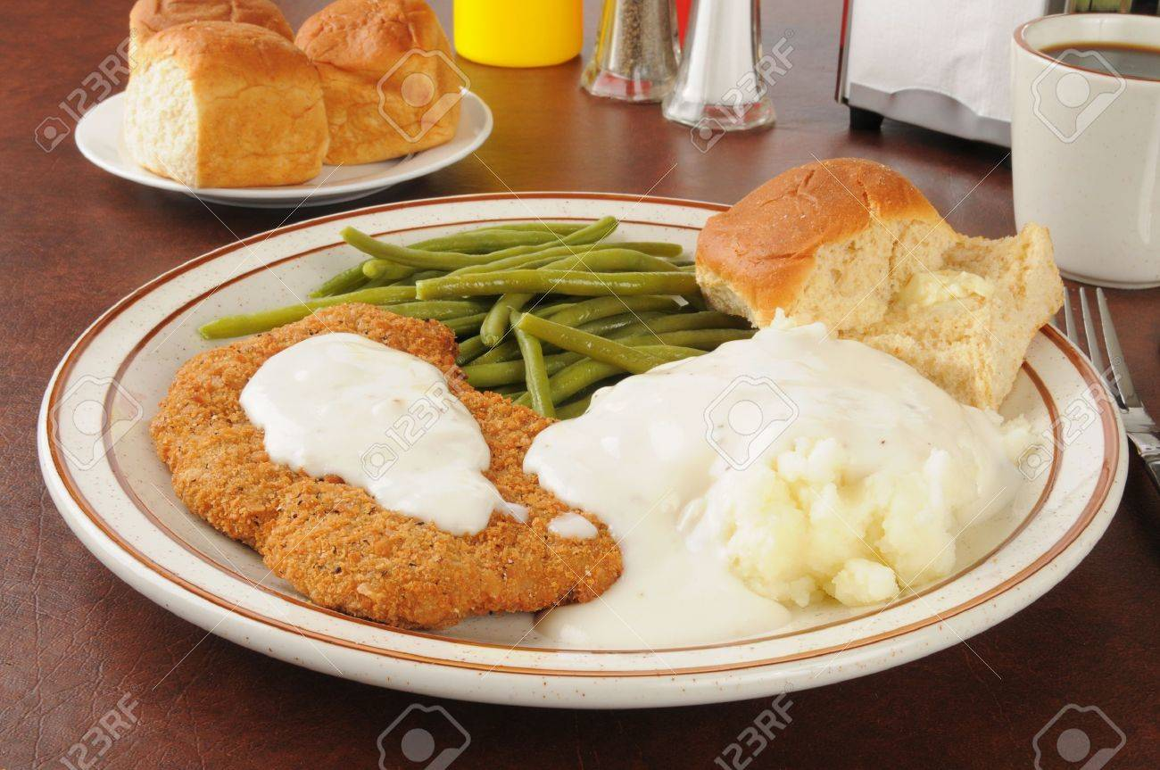 Chicken fried steak with mashed potatoes and country gravy - 16851017